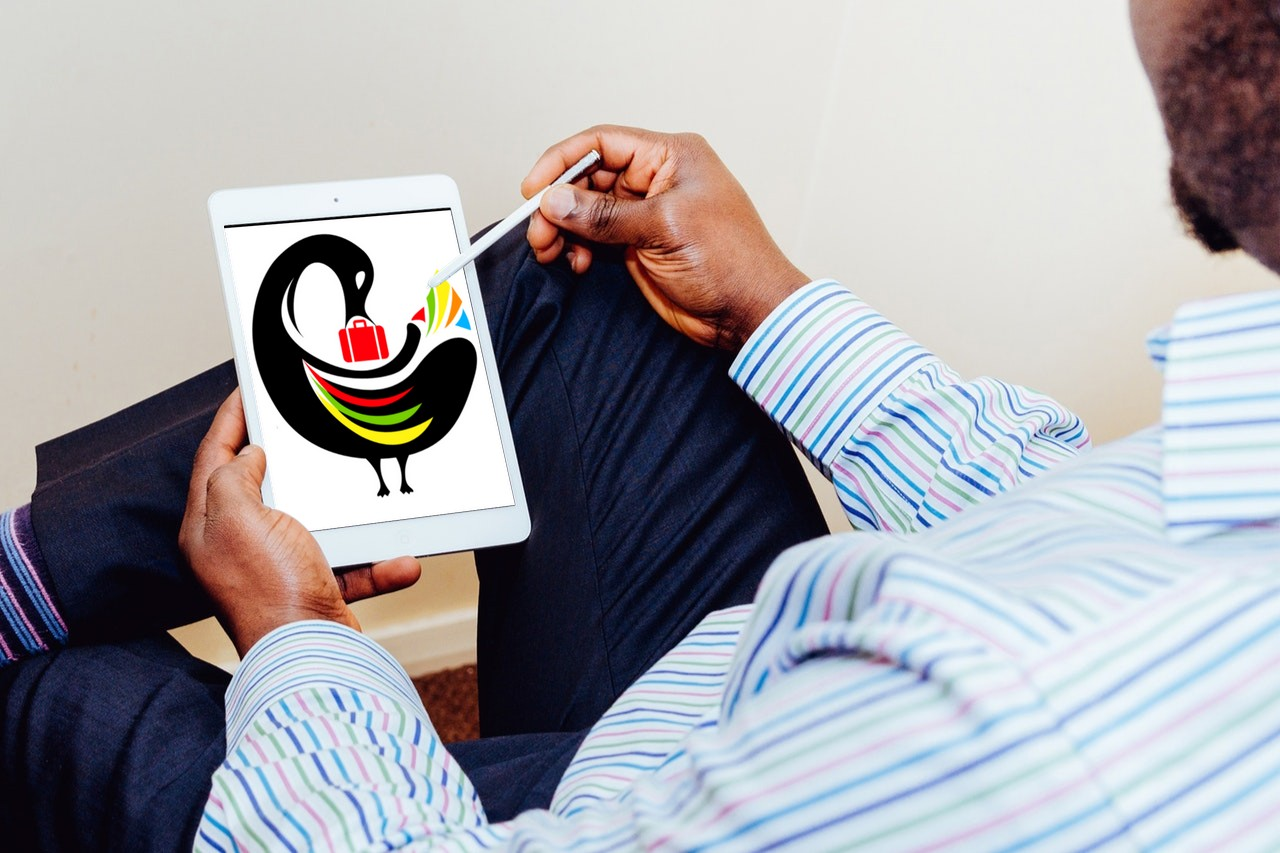man on ipad with logo